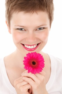 smiling-woman-with-a-flower